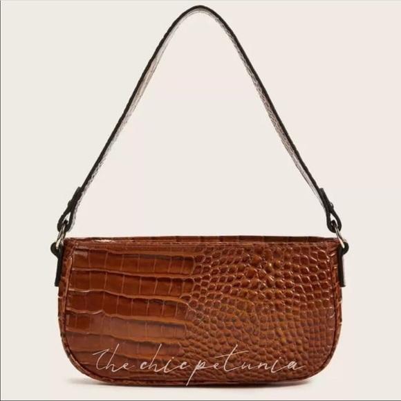 The Chic Petunia Handbags - Medium brown embossed vegan leather baguette bag